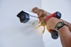 Teachnician installing CCTV camera System for security area.